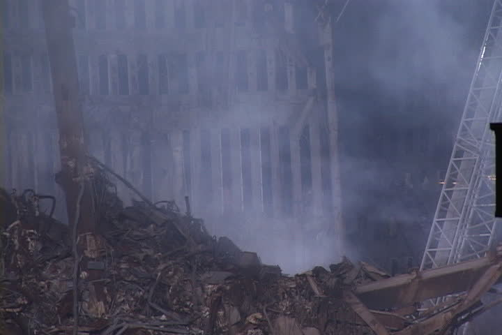 NEW YORK CITY - SEPTEMBER 28, 2001: Rising smoke and pile of rubble in front of remains of World Trade Center structure.