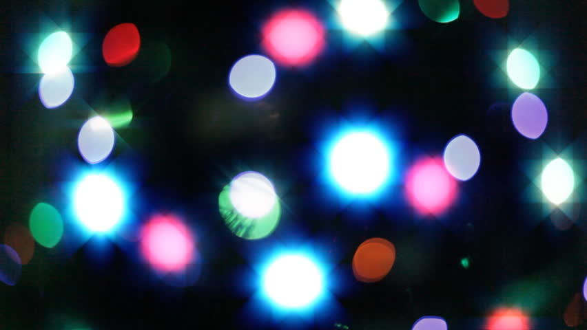Seamless video background of blurred flickering Christmas lights. Perfect for any kind of holidays or celebrations events.