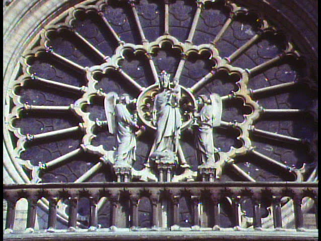 Paris, France, Notre Dame, close up of rose window, zoom out to wide shot of two towers - SD stock footage clip