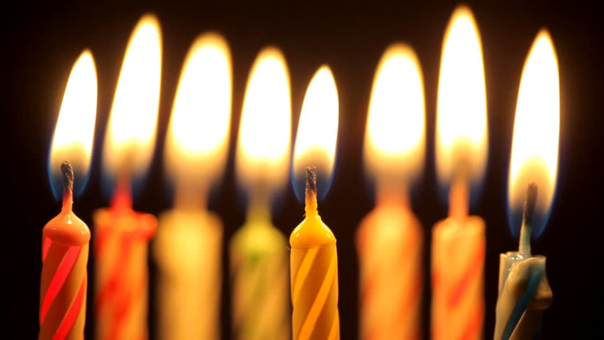 blowing out birthday candles - HD stock video clip