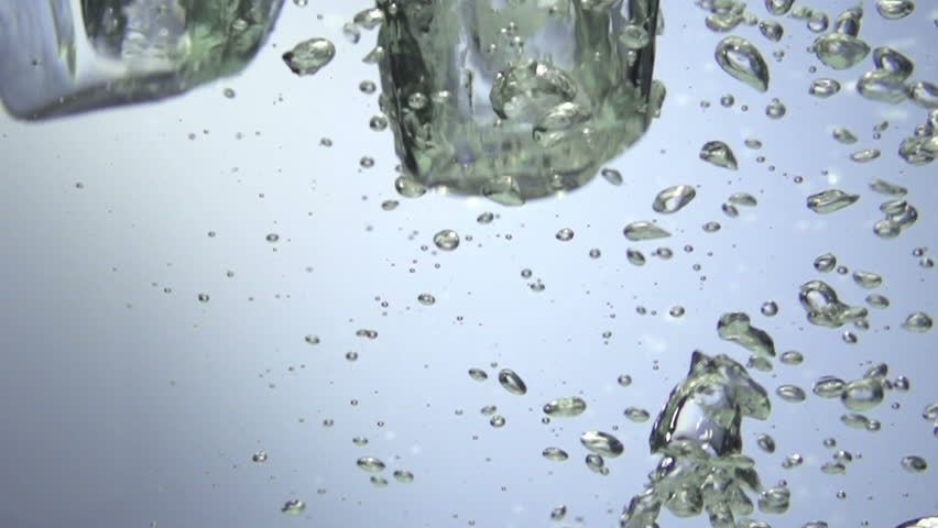 Fresh lime dropped into water with splash