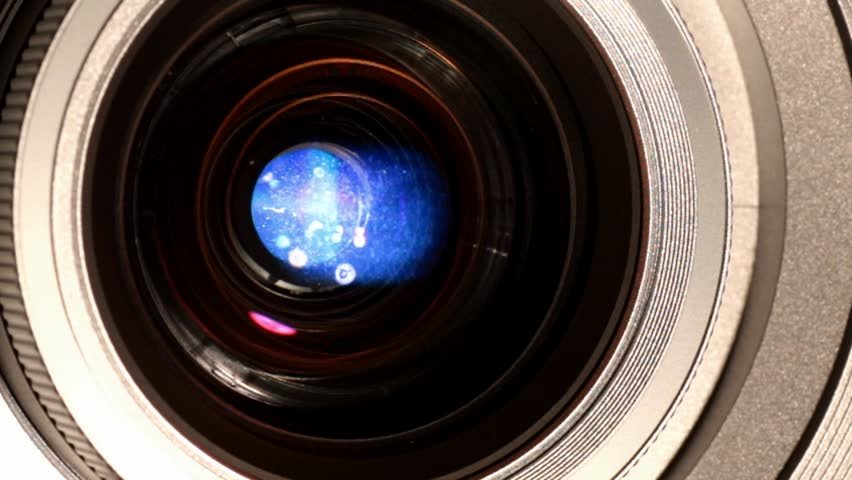 close up of movie projector lens with light - HD stock footage clip