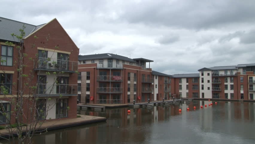 Brand new flats built around a canal basin. - HD stock footage clip