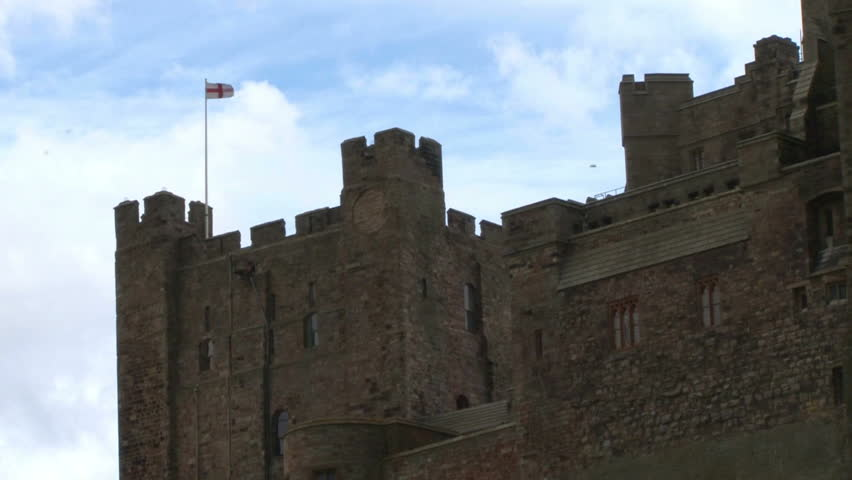 Turret of Bamburgh Castle flying an English flag. - HD stock video clip