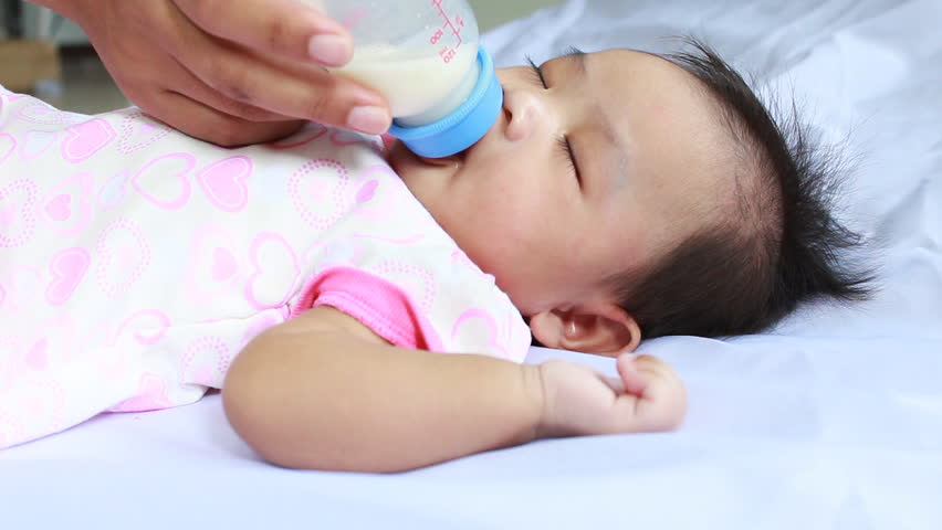 Little  baby drinking milk - HD stock footage clip