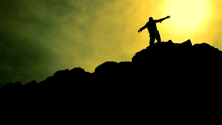 Man Climbing Rocks Lifting Hands in Worship Pose Color Enhanced Background HD
