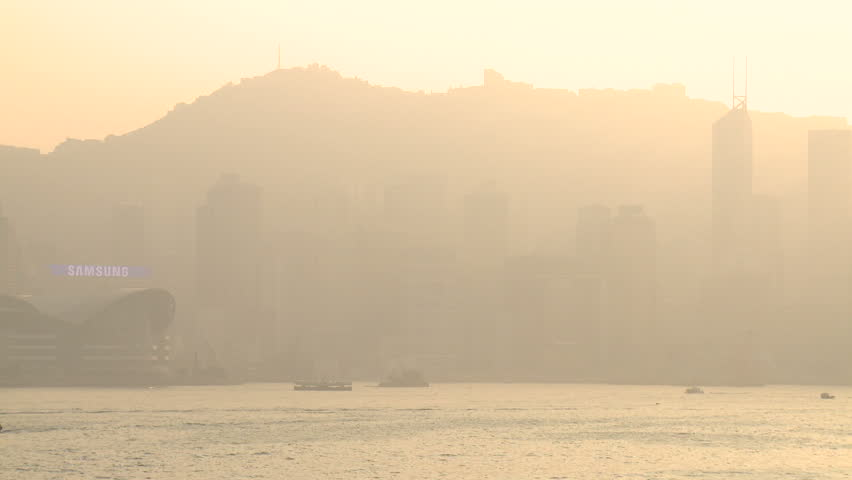 Smog Pollution Sunset Over Asia Megacity Hong Kong. Air pollution and choking