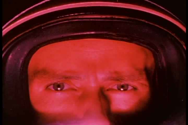 1960s - A close up of an astronaut as he contemplates being put into a rocket and launched.