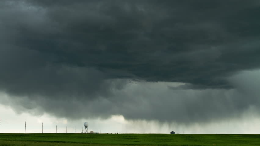 Massive thunderstorm moves over eastern Colorado, with churning storm clouds and virga. HD 1080p timelapse.