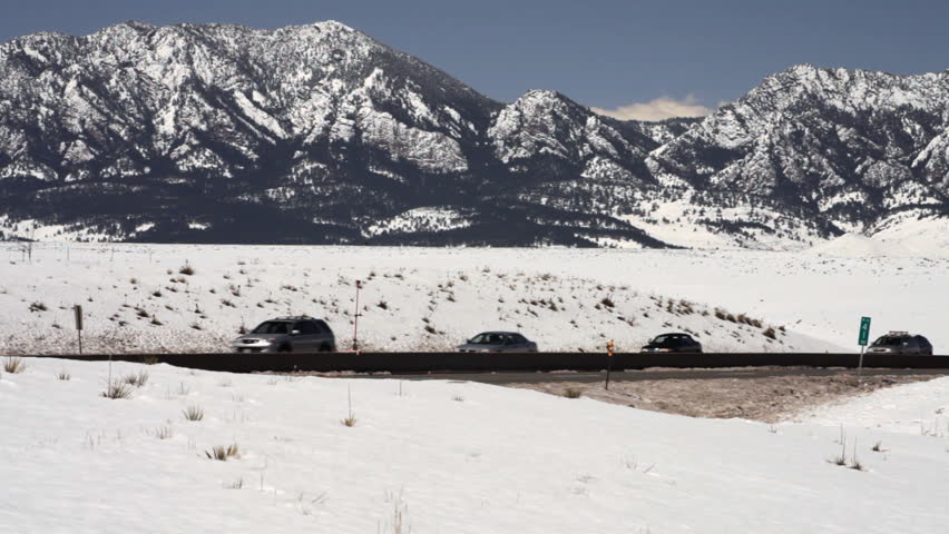 traffic on a major highway in the snowy mountains of Denver - HD stock footage clip
