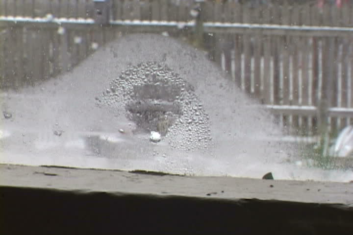 A fun little happy face drawn on a window during snow storm in Oregon. - SD stock footage clip