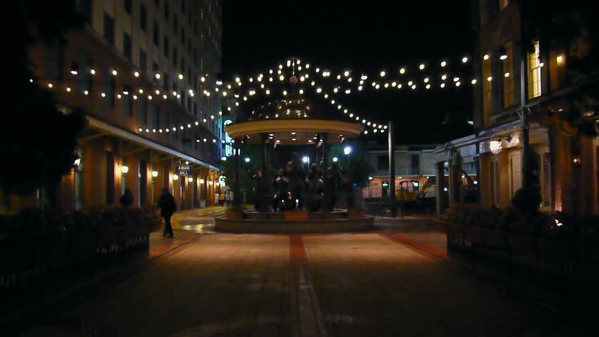 New Orleans, Louisiana -  June, 2011 -  Fulton Street Gazebo with jazz musician sculpture at night.