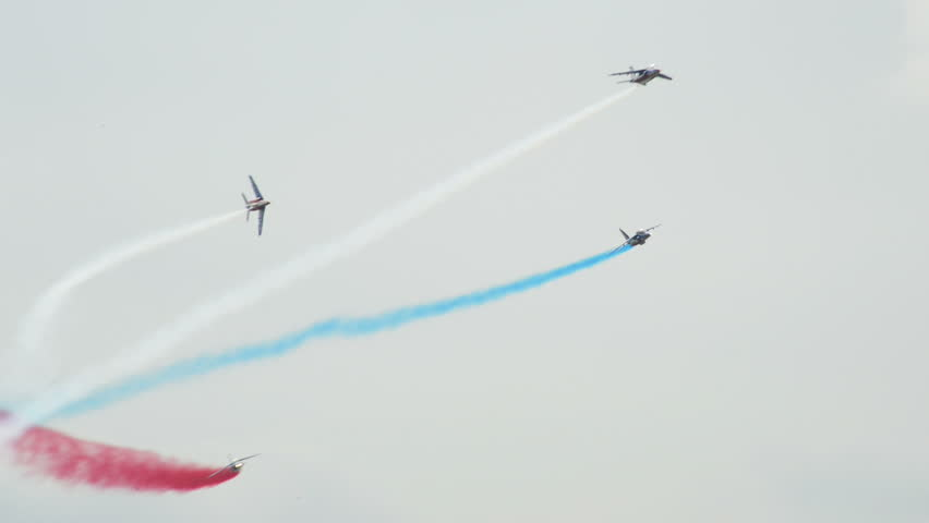 VOLKEL, NETHERLANDS - June 14 2013: Patrouille France four soloists roll around during an airshow at Volkel, Netherlands, June 14, 2013