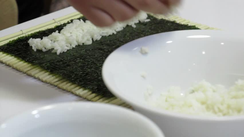 Cook preparing Makizushi. Delicious sushi rolls
