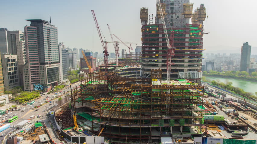 Seoul City Lotte World Tower Construction Site 225) Time lapse of traffic and a huge construction site in Seoul, Korea. Jamsil Lotte World Tower. - HD stock video clip