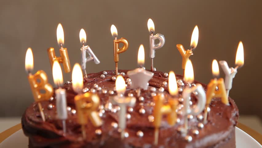 A Chocolate Birthday Cake With Candles Stock Footage Video ...