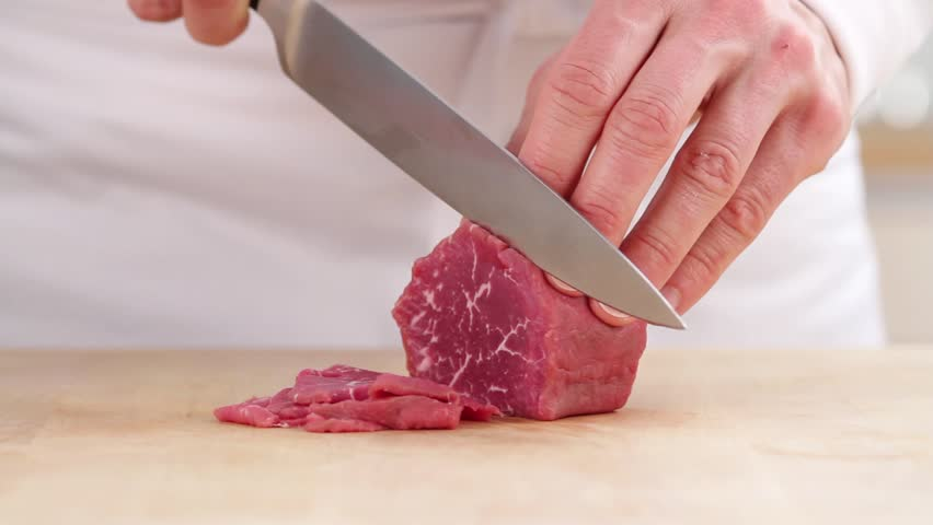 Frozen beef fillet being finely sliced - HD stock footage clip