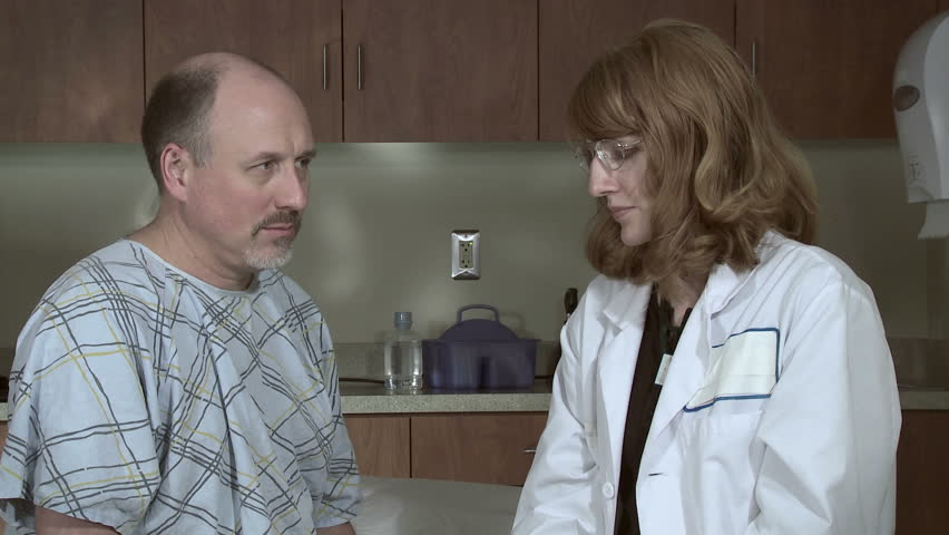 Female doctor gives an injection, possibly a flu shot, to a mature male patient.  No arm swab in this clip. - HD stock video clip