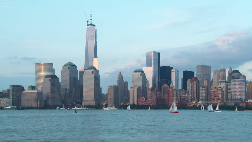 Timelapse sequence of boats on the Hudson River as sunset approaches, with the Freedom Tower and lower Manhattan skyline of New York City in the background. | Shutterstock HD Video #4239137