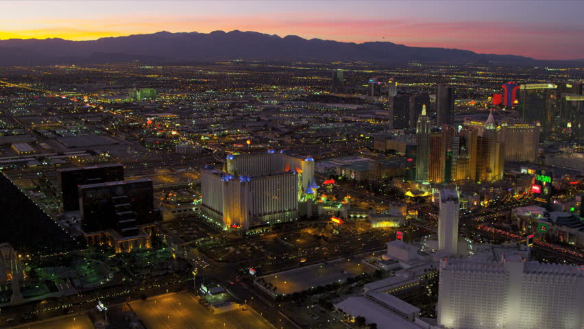 Las Vegas - January 2013: Aerial sunset image of illuminated Las Vegas at dusk Hotels and Casinos, Nevada, USA, RED EPIC | Shutterstock HD Video #4243241