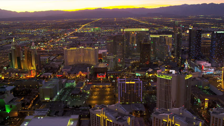 Las Vegas - January 2013: Aerial sunset image of illuminated Las Vegas at dusk Hotels and Casinos, Nevada, USA | Shutterstock HD Video #4243763