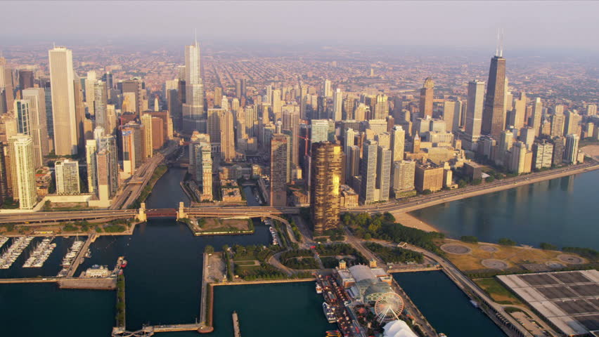 Aerial sunrise view downtown Chicago River, skyscrapers John Hancock Building, Trump Tower, marina district, Navy Pier, Chicago, Illinois, USA, shot on RED EPIC #4249406