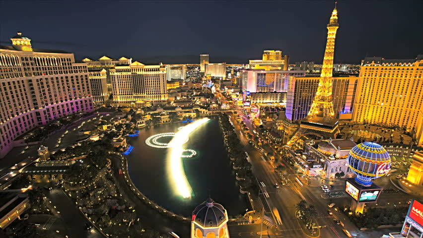 Las Vegas - January 2013: Illuminated view Bellagio Hotel fountains nr Paris Hotel, Las Vegas Strip, USA, Time Lapse