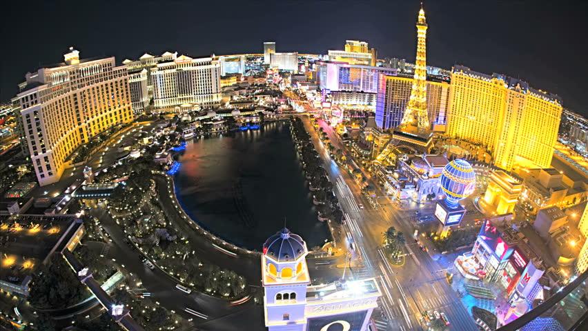 Las Vegas - January 2013: Illuminated wide angled view Bellagio fountains nr Caesars Palace, Las Vegas Strip, USA, Time Lapse | Shutterstock HD Video #4262627