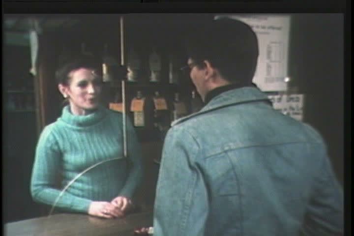 1980s - A young man makes his way into a party during the 1980s - SD stock footage clip