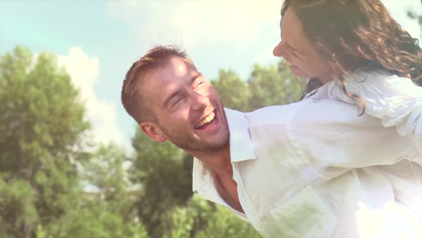 Happy Couple Having Fun Outdoors. Laughing Joyful Family. Freedom Concept. - HD stock footage clip