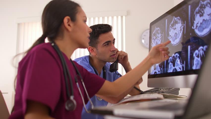 Hispanic doctors working in the office | Shutterstock HD Video #4286936