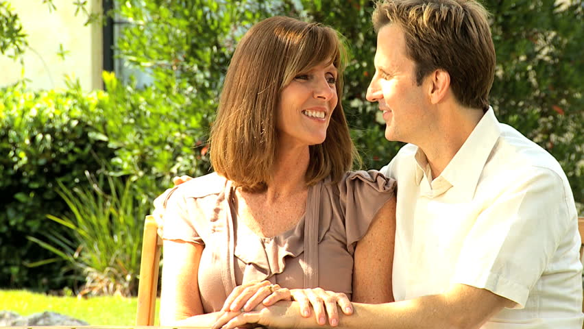 Attractive happy Caucasian couple enjoying time together home garden - HD stock video clip