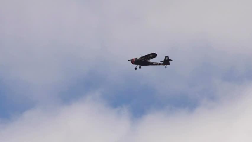 HOMER, AK - MAY 2013 - Functional vintage restored World War 2 bomber/scout airplane flies in blue skies in May 2013 in Homer, Alaska - HD stock footage clip