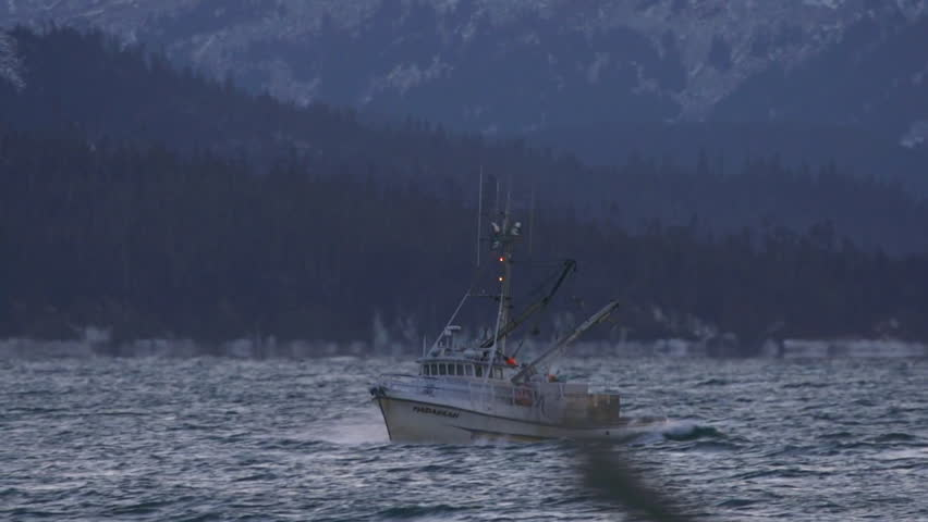 HOMER, AK - JANUARY 2013 - Frigid salt water spray splashes over the bow of a