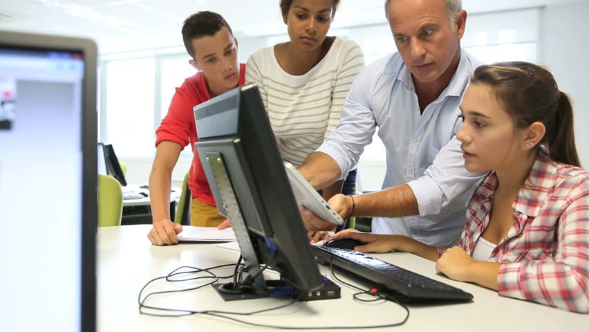 Teacher with students in computing class | Shutterstock HD Video #4326824