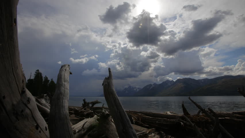 Time lapse of threatening storm clouds gathering over a lake in Yellowstone National Park, Wyoming - HD stock video clip