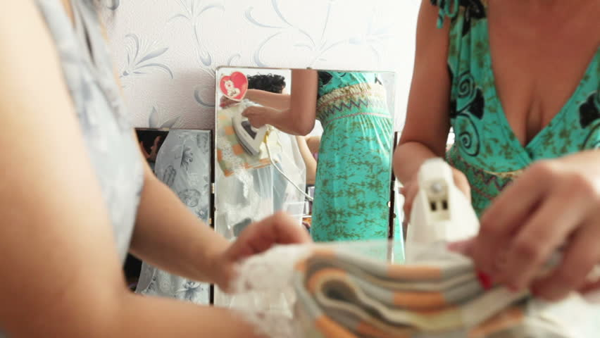 Ironing service on the bride's veil weight.