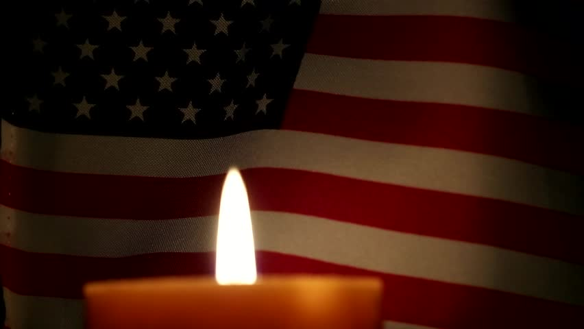 American flag and candle burning.