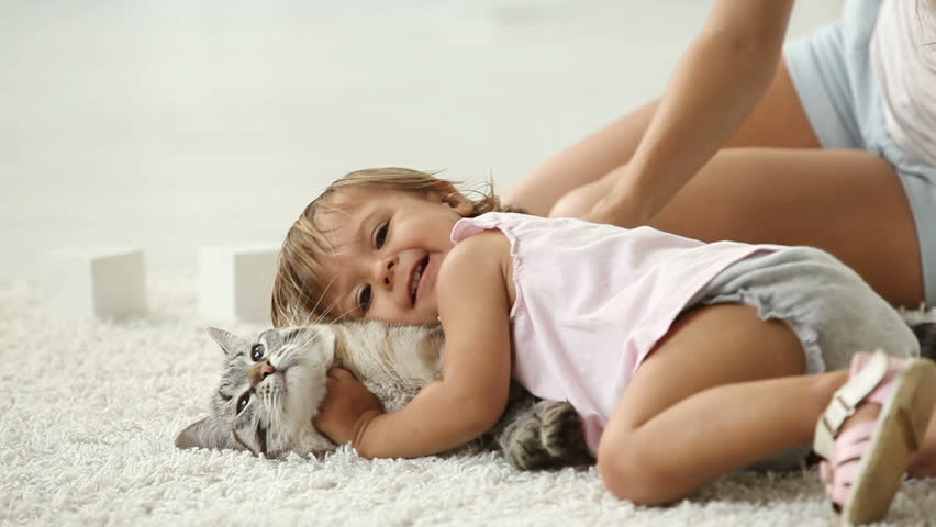 Cute girl cuddling with her furry friend - HD stock footage clip