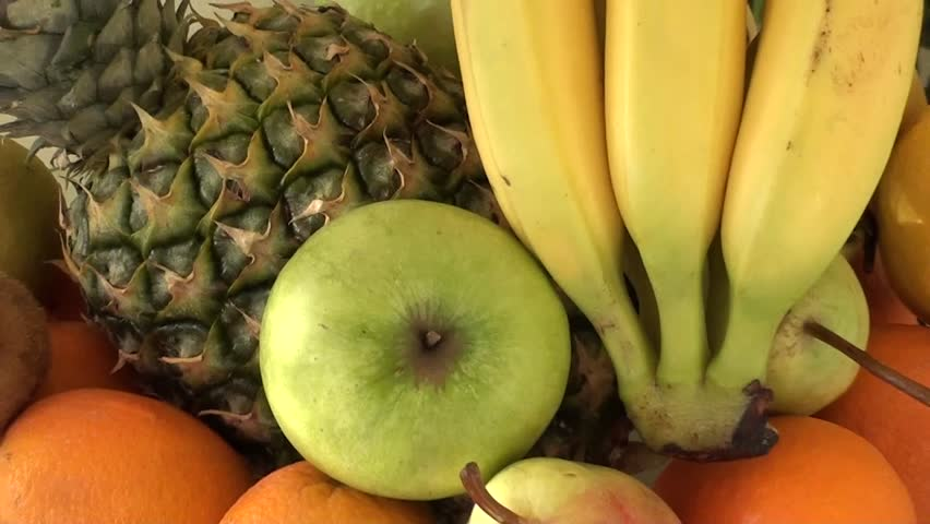 Dish full of fruits on the table, zoom out - HD stock footage clip