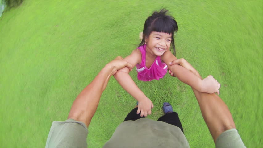 Little asian girl playing in the grass, running into man's arms. pov slow motion.    - HD stock footage clip