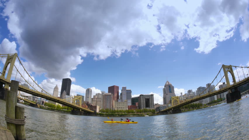 A fish eye time lapse view of river activity on Pittsburgh's north shore. - HD stock video clip