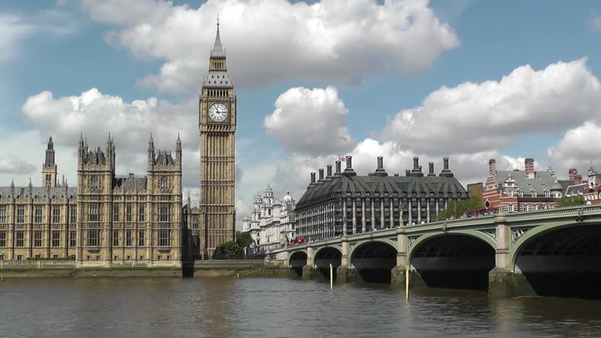 The Palace of Westminster in London, with Elizabeth Tower and Westminster Bridge, viewed from across the River Thames.