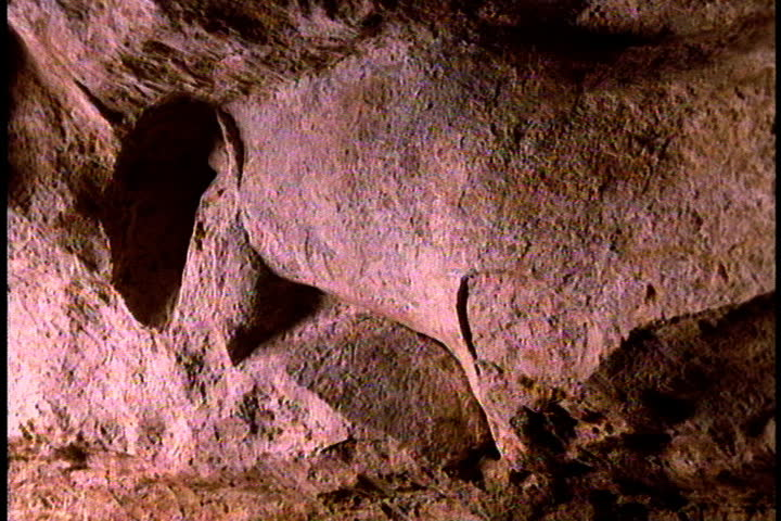 Image of horses head carved into cave wall by early humans