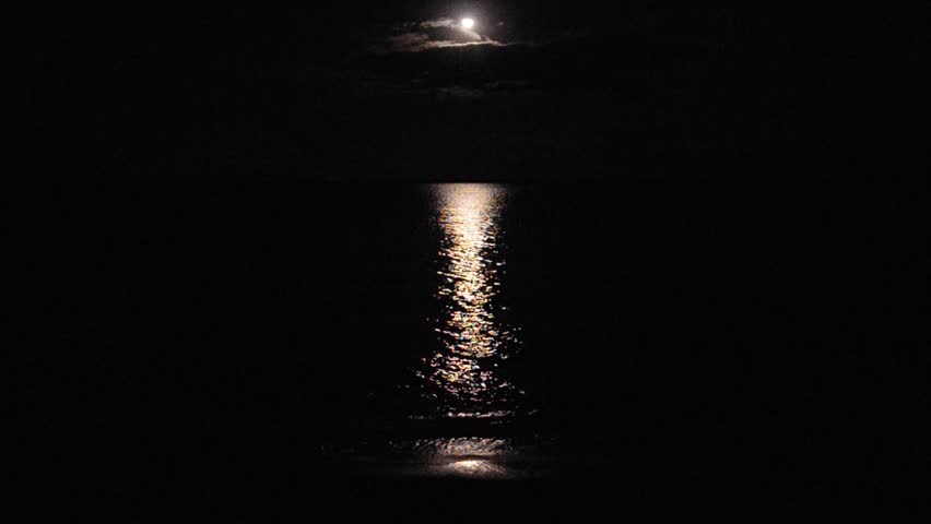 full moon and reflection shimmers over remote beach and crashing waves, far north queensland, australia