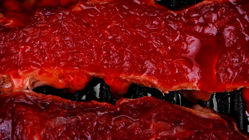 raw bloody beef fillet steaks on black teflon grill plate 1920x1080 intro motion slow hidef hd - HD stock video clip