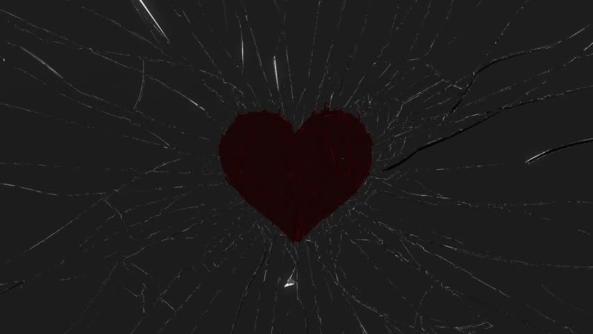 Shattered glass: red broken heart shape. Alpha is included - HD stock footage clip