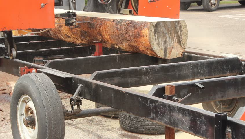Cutting A Log : Large portable band saw cutting a log into boards stock