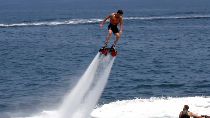 "ALICANTE, SPAIN  AUGUST 04: The ""Flyboard"" is a new sport for lovers of water sports. His spectacular amazes all swimmers.; Spain; on august 04, 2013 in Alicante."