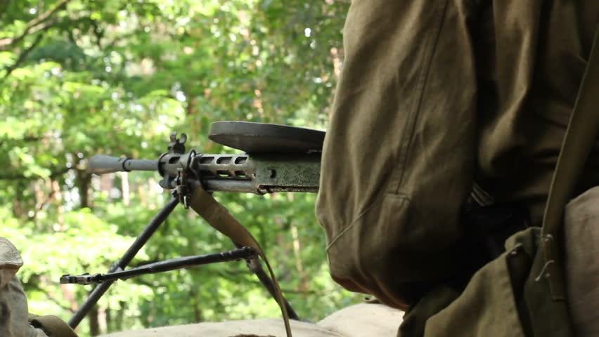 Vintage machine gun spits out series of bullet. World war 2 reconstruction